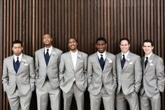 grey suits for the groom and groomsmen.
