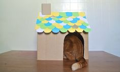 Whip up a quick Cardboard cat house! Perfect for...well, your cat, and anyone else who really loves cats. They'll think you're a genius. via The Thousands #cat #make #diy #cats #gifts #kids #cat #handmade