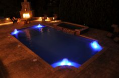 Gunite Pool & Spa, Nightview.  Colored Lighting, Fireplace, Foam Jets in Pool, Paver Stone Deck by aspools, via Flickr