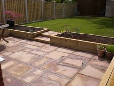 kleiner garten Landscaping in Chesterfield includes Indian stone patio, hit n miss fencing, turf lawn and sleeper beds Back Garden Design, Backyard Garden Design, Landscaping Retaining Walls, Backyard Landscaping, Backyard Patio, Backyard Ideas, Garden Steps, Lawn And Garden, Back Gardens