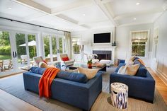 Whether the whole family is over or just a few relatives this large living room will hold everyone for some entertainment. Outdoor Furniture Sets, Room, House, Spacious Kitchens, Porch Fireplace, Contemporary Decor, Outdoor Furniture, Home Decor, Large Living Room