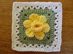 Daffodowndillies is an old-fashioned word for daffodils. Beautiful yellow daffodils I saw on our walks this spring inspired me to create this afghan square. Recently having worked with the crossed double crochet stitch, I chose it for the trumpet of the daffodil.