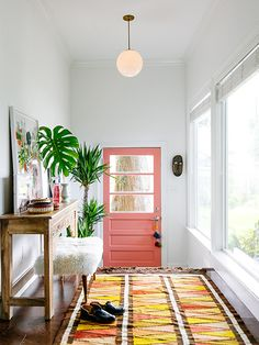 This mudroom makeover proves you can make a big impact without breaking the bank. Consider brightening up your mudroom or entryway with a splashy new door color. A graphic rug and fresh botanicals create a space you'll look forward to coming home to. Interior Exterior, Home Interior, Interior Decorating, Decorating Ideas, Decor Ideas, Interior Ideas, Rug Ideas, Interior Doors, Decorating Websites