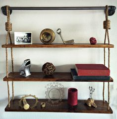 3 Tier Shelves Rustic Chic  Approx. Approx 32 Tall Approx 30 Wide Approx 5 1/4 Deep Approx 9 Distance between shelves In this listing we have a great looking Rustic style shelf, made of industrial pipe, wood & twine. If you would like a different stain, please just send us a message Photos in this listing are stock, each piece will be similar not exact, making each piece a unique work of art. Wood may may vary in color, character, texture  If you like this, but prefer a different size or…