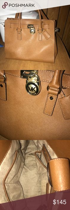 Michael kors large north south hamilton tote. Beautiful EUC Michael kors hamiliton. No wear or tear at all. No stains or rips. I believe this was used maybe once. Has handles and a long shoulder strap. Luggage is the color with gold hard wear and would consider this a large bag Michael Kors Bags Shoulder Bags