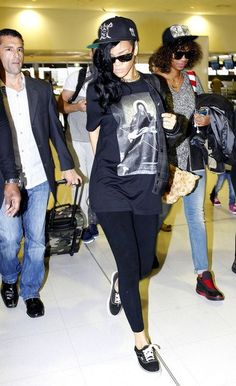 Rihanna- X-Carhartt Schopenhauer Varsity Jacket, Black Givenchy Printed T-Shirt & Black Vans Era Sneakers