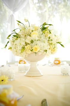 white + pale yellow centerpiece in ceramic pedestal bowl by Yvonne Chapman of Yvonne Design (Butter Yellow Wedding)