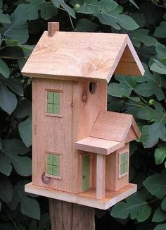 Pictures of Bird Houses | Cedar Ladder Perch Bird House has front hinges for easy cleanout.