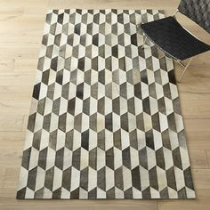 Shop Benjamin Hide Rug. Tonal trapezoids of white, brown and grey hair-on-hide take formation on the floor. Adds a sophisticated graphic element to any room. Each will naturally vary in color.