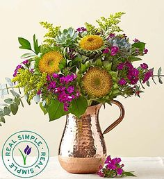 Add lush green succulents to a gathering of sunflowers and other colorful blooms, and you get an impressive arrangement with all the charm of fall itself! Plus, the bouquet arrives in a unique, trendy textured brass pitcher that highlights the vibrancy of the flowers while adding to their natural beauty!