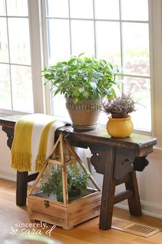 This rustic distressed wooden table and other furniture are juxtaposed with crisp white and elegant pieces of décor to create a sophisticated, shabby chic home in this beautiful home inspiration post.