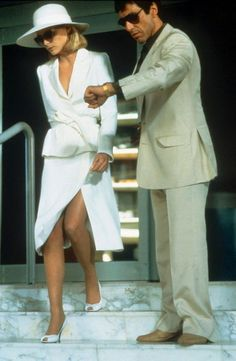 michelle pfeiffer as elvira hancock and al pacino as tony montana in scarface, brian de palma Michelle Pfeiffer Scarface, Elvira Hancock, Mode Collage, White Suits, White Skirt Suit, White Pantsuit, White Dress, Green Dress, Hollywood