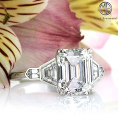 This spectacular emerald cut diamond engagement ring is truly sensational. It all starts with the enchanting 3.74ct emerald cut center diamond. It is GIA certified at F-VVS2. It is exceptionally white, practically flawless and cut to perfection.