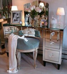 Mirrored dressing table and low backed chair