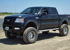 Slight lift, nice rims, and beefy tires!  Love it!  Love me some trucks!