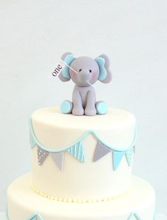 THIS ITEM IS READY TO SHIP IN 2 DAYS!    This cute Baby Elephant Cake Topper is perfect for a baby shower or birthday celebration.    This listing