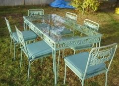 Vintage Patio Set  Yard Sale  $25- I spent 3 x more changing the chair covers.  I use the tabe inside the house over the winter months. Its one of my fav things.