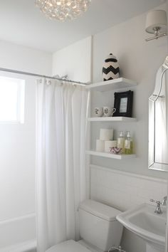 346 Living: Absolutely beautiful bathroom with gray walls framing white floating shelves filled with ...
