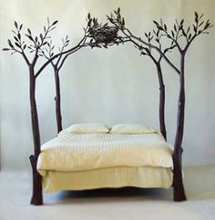 with some kind of sheer fabric draped over the branches, love. Even if its just on headboard side!