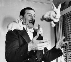 Juggler Ben Beri tosses bunnies into the air, ca. 1950