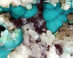 Parnauite, Cu9(AsO4)2(SO4)(OH)10•7(H2O), Prehistoric dump, Schwarzleo District, Schwarzleograben, Hütten, Leogang, Saalfelden, Salzburg, Austria. Shell-shaped needle-like blue-green crystal coverings on Strashimirite. Fov 2 mm. Collection/Copyright: Manfred Früchtl