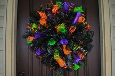 Halloween Spiral Wreath, Halloween Wreath, Spiral Wreath, Deco Mesh Wreath, Wreath, Halloween, Door Wreath, Orange Wreath. $65.00, via Etsy.