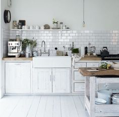 kitchen - white floor, cupboards and tiles