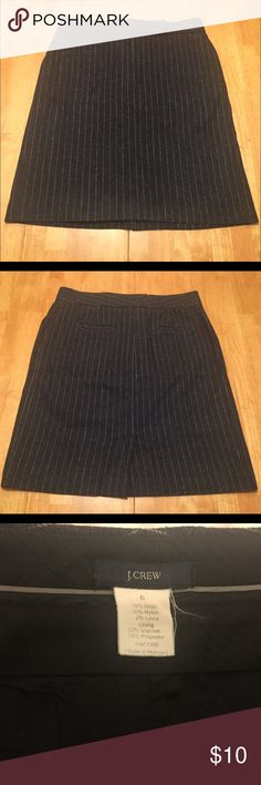 """J. Crew grey wool pinstripe skirt EUC. J Crew dark heather charcoal grey a-line skirt with light grey pinstripes. 78% wool, 20% nylon, 2% Lycra. 62% viscose, 38% polyester lining. 5"""" zip front with waistband tab and double hook-and-bar closure. Slash front pockets on side seams. Welt back pockets. Measurements (flat): waist 16"""", hip 20"""", length 21"""", 4.5"""" slit in center back. Dry clean only. Care tag has been removed. I think the style is 61187. No trades please! J. Crew Skirts A-Line or Full"""