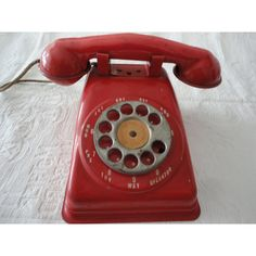 Red Metal Toy Rotary Telephone Vintage The Steel Stamping Co Lorain... ($35) ❤ liked on Polyvore featuring home, home decor, vintage home accessories, red home decor, metal home decor, vintage home decor and red home accessories