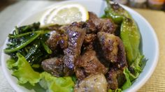 a bowl of rice topped with beef , lettuce and sweet pepper 2013-07-08