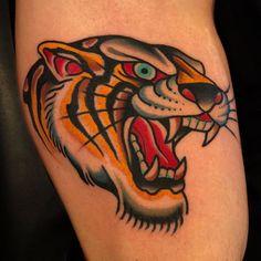Tiger!!! Done at @boldwillhold.tattoo ... #samuelebriganti #posttradtattoo #boldwillholdfirenze #boldwillhold #sunskintattoomachines #tigertattoo #traditionaltattoo | Artist: @samuelebriganti Traditional Tiger Tattoo, Traditional Ink, American Traditional, Wolf Tattoos, Leg Tattoos, Tattos, Flash Tats, Tiger Design, Old School