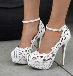 White lace cut-out heels with ankle strap.
