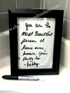 It's just a sheet of (recycled) notebook paper in a cheap frame.  We keep it in our master bathroom and use it to write little love notes back and forth to each other nearly every day.  You can also fancy it up with scrapbook paper, but I went the tree saving root with a little less dye.  You can also just write on the mirror in dry erase marker, but I always feel guilty erasing MacGyver's beautiful words when I need to do my hair.