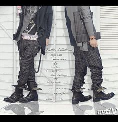 Hanging dark-plaid suspenders on adventurous Japanese gender-neutral Goth-punk outfit.  I can dig this!