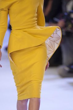 Bold yellow dress with 3D sculptural silhouette & a glimpse of contrasting…