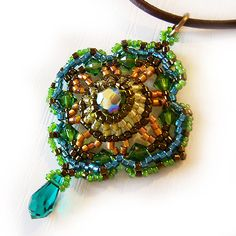 Green Romantic Victorian Pendant with Swarovski crystals and Delica Beads. $35.00, via Etsy.