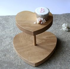 A beautifully simple Oak heart cake stand for those heavenly cakes. They are the perfect excuse why you should make more time for leisurely afternoon teas. For cheese lovers this Oak stand is a lovely way to display your fine cheese and grapes. A lovely gift and ideal for entertaining social butterflies! Lovingly handmade using solid Oak, sourced from sustainable forests and finished with Danish oil. Large: L22cm x W 22.5cm x D 2.5cm approx Small: L16.5 x W 15.5cm x D 2.5c... £45.00