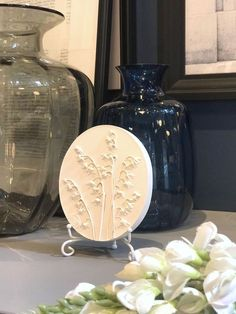 "Scandinavian botanical bas-relief ""Lilies of the valley"" shelf decor by DinaArtDecor. Oval rustic planter wall decor made from fresh flowers. Wall art tile. Lilies of the valley oval botanical panel is ideal for decorating the entrance hall, living room, kitchen, bedroom or baby room"