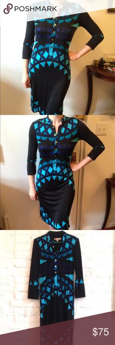 Mara Hoffman Silk Dress Mara Hoffman silk knit dress in black with a blue and turquoise pattern. Six shell buttons down the front. Knit has stretch giving the dress a clingy flattering fit. Two side slits at hem. 3/4 length sleeves. Two small imperfections noted in last photos to the left of each dime--a light spot near the buttons and a snag. 100% silk, made in USA. Mara Hoffman Dresses
