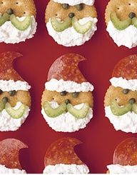 Antipasto Santa Appetizer; How I made them...Face is a round Cracker / Beard and hat fleece is cream cheese / Mustache is green olive / Eyes and nose is small pieces of black olive.