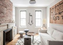 Small living room in white of New York City apartment with exposed brick wall. Monochromatic Living Rooms in White Full of Personality!