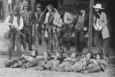 """I love this Henry Diltz shot of a reenactment of the Dalton Gang shoot out for the Eagles' Desperado Album. The  """"dead"""" are Jackson Browne, Glenn Frey, Don Henley, Bernie Leadon, Randy Meisner and J.D. Souther."""