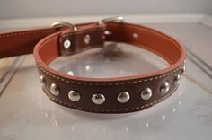 Handmade brown leather dog collar with silver studs for medium to large breed dogs. The is very cost and the stain is vibrant. Fits Neck: 16in-21in/41cm-53cm (Adjustable Size) Width: 1in/2.5CM  Fits all Medium to Large dogs including German Shepherd, Pitbull, Labrador Retriever, Golden Retriever, Bulldog, Rottweiler, Collie, German Shorthaired Pointer, and more.  SIZE: For Collar: Measure the neck circumference where you would like the collar to sit. For Harnesses: measure the chest...