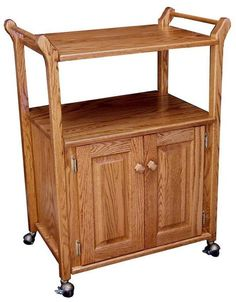 Amish Hardwood Bar Cart Roll up the home bar. Built in oak or cherry wood. Lower cabinet includes adjustable shelf. Great storage cart for craft materials or to display plants. #barcart #rollingcart #storagecart