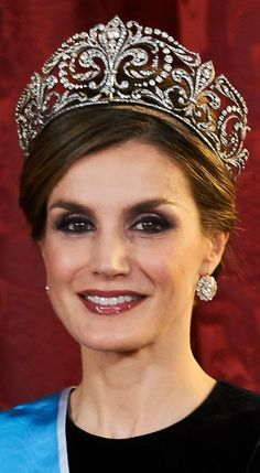 Worn by Queen Letizia of Spain: Tiara de las Flores de Lis; Made of platinum and diamonds forming the Fleur-De-Lys, the heraldic emblem of the House of Bourbon, dates back to King Alfonso XIII who offered it to his bride Princess Victoria Eugenie of Battenberg, later known as Queen Ena, as a wedding gift in 1906. The Fleur-De-Lys Tiara is said to be the most cherished tiara of the Royal Family of Spain. Made by Ansorena 1906.