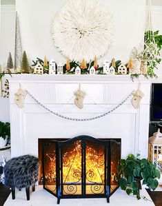 Our celestial fairy light spray features a singular bunch of warm, white LED lights joined at the start but separated into ten bendable, silver wire strands - perfect for holiday or wedding centerpieces. Plug-in the spray, and wrap, weave or drape to Fireplace Cover Up, White Fireplace, Christmas Fireplace, Winter Wedding Decorations, Light Decorations, Christmas Decorations, Fireplace Decorations, George Nelson, Twinkle Lights