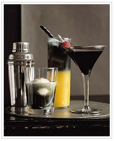 Black Vodka Drink Recipes!!!   Ghost in the Graveyard  2 ounces black vodka  2 ounces creme de cacao or coffee-flavored liqueur  1 scoop vanilla ice cream  Pinch of finely grated nutmeg, for garnish In a glass, combine vodka and creme de cacao, and set aside. Place a scoop of ice cream in a highball glass, and slowly pour vodka mixture over ice cream. Garnish with nutmeg; serve immediately.