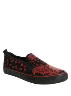 f324b1d2cb32 Black slip-on shoes with allover red paisley bandana print and black  outsoles.