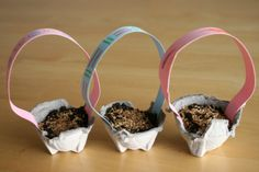 Growing Easter Grass - using an egg carton, some soil, grass seeds and construction paper for a handle, you can make these mini-Easter baskets! Don't forget to water :-)