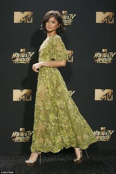 Lovely: The sheer and very plunging gown showed off the young beauty's slender and tall fr...